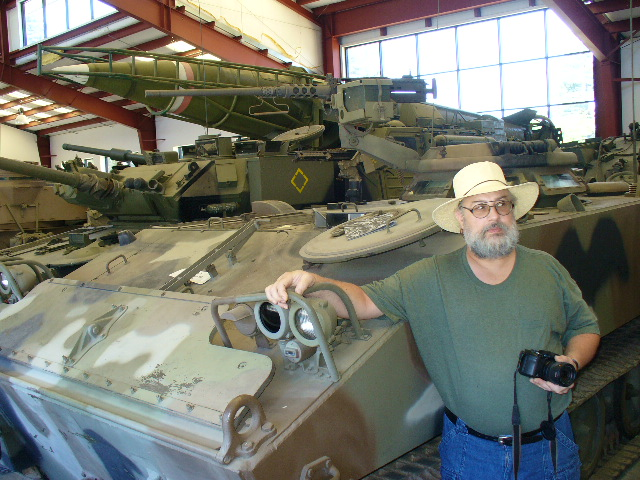 Rick Nance in front of an M-114 like he drove in the army